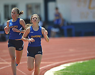 Oxford High's Callie Mayo (left) and Audrey Dayan run in the 3200 meters a high school track meet in Oxford, Miss. on Saturday, April 23, 2011.