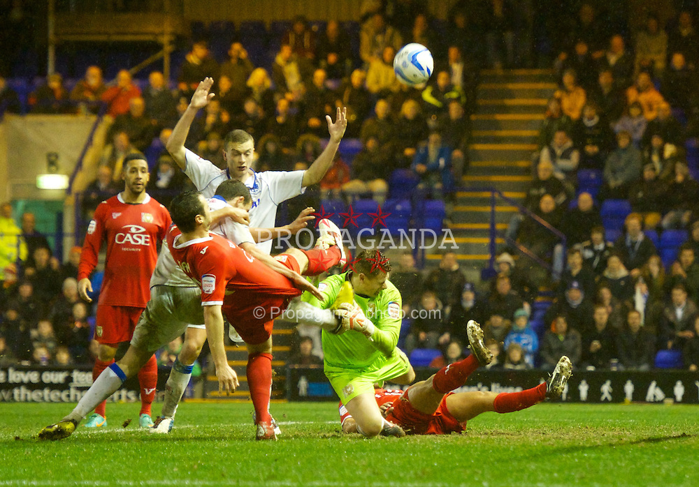 BIRKENHEAD, ENGLAND - Friday, November 16, 2012: Milton Keynes Dons' goalkeeper David Martin and Alan Smith clash during the Football League One match against Tranmere Rovers at Prenton Park. (Pic by David Rawcliffe/Propaganda)