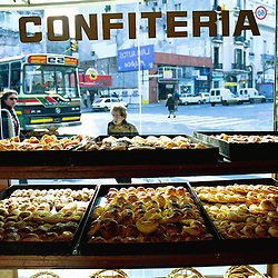 BUENOS AIRES, ARGENTINA:  Women pass by a local pastry shop in Buenos Aires, Argentina. .(Photo by Ami Vitale)