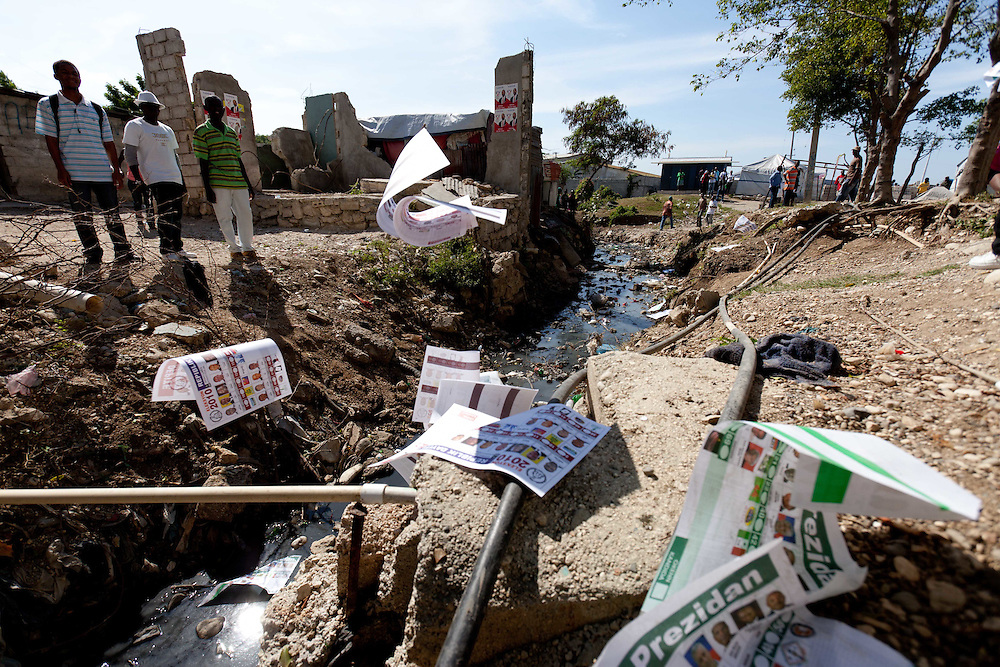 Ballots are thrown into a drainage canal after a stampede in a voting center which happened when Michel Martelly supporters, after rumors of election fraud, entered a voting station chanting and marching. Ballot boxes were smashed and ballots lost during the chaos.