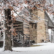 The Adamson cabin during a spring snowstorm. Owned and operated by the Lawrence County Historical Society.