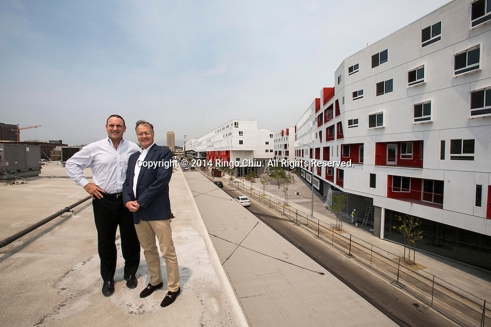 Bill McGregor, right, of McGregor Brown Company and Chuck Cowley of Cowley Real Estate Partners at One Santa Fe, a massive residential project in the Arts District. <br /> (Photo by Ringo Chiu/PHOTOFORMULA.com)