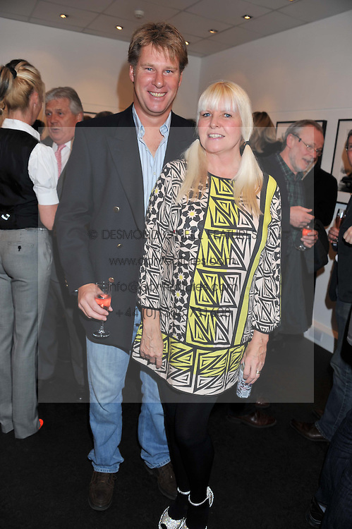 ANDREW & LINDSEY RAITT she is the widow of Bob Carlos Clarke at a private view of the late Patrick Lichfield: Nudes at The Little Black gallery, 13A Park Walk, London SW10 on 26th April 2012.