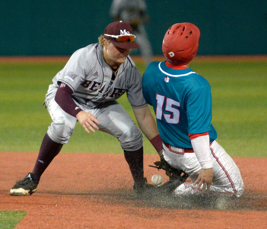 gbs041317g/SPORTS --  UNM's Jared Mang, 15, as Missouri State second baseman Aaron Meyer drops the ball in the fourth inning of the game at the Santa Ana Star Field on Thursday, April 13, 2017. (Greg Sorber/Albuquerque Journal)