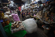 A man pushes a loaded trolley at  the Huembes Market in Managua, Nicaragua