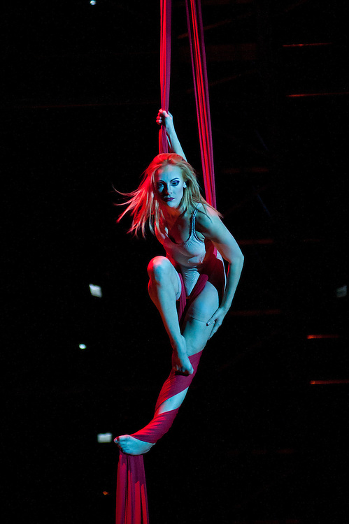 London, UK - 4 Janaury 2014: the Aerial Contortion in Silk act performed by Julie Cameron during the dress rehearsal of Quidam at the Royal Albert Hall. (available only for editorial coverage of the Production)