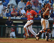 Ole Miss' David Phillips (25) reaches on an error, scoring Ole Miss' Alex Yarbrough vs. Auburn during the Southeastern Conference tournament at Regions Park in Hoover, Ala. on Friday, May 28, 2010.  (AP Photo/Oxford Eagle, Bruce Newman)