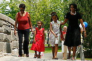 Michelle Obama(R), wife of Democratic presidential hopeful Senator Barack Obama, walks with daughters Malia(2nd R) and Sasha(2nd L) and her mother  Marian Robinson(L) make their way to a rally in Concord, New Hampshire June, 2, 2007. .