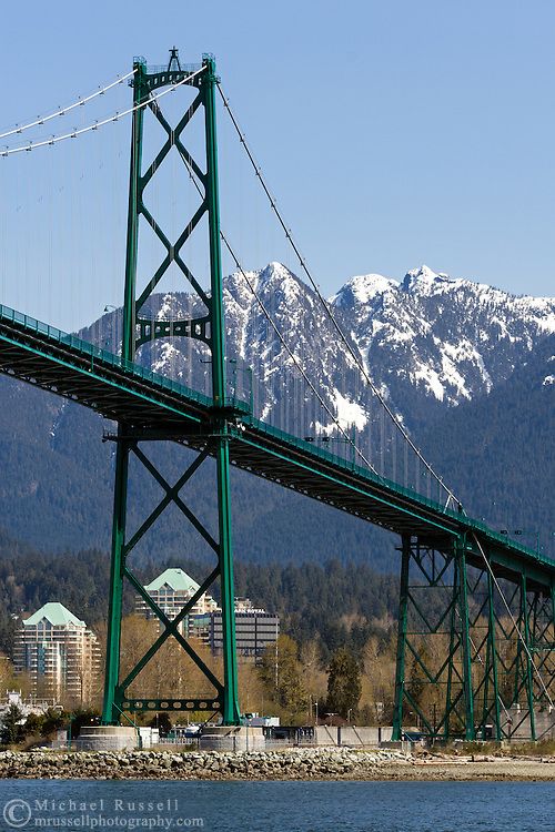 Grouse Mountain rises behind the iconic Lions Gate Bridge and North Vancouver in British Columbia, Canada