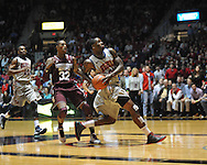 "Ole Miss' Murphy Holloway (31) scores against Mississippi State's Craig Sword (32) at the C.M. ""Tad"" Smith Coliseum on Wednesday, February 6, 2013. (AP Photo/Oxford Eagle, Bruce Newman).."