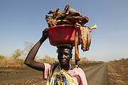 A woman from Lange fisherman village carries dried fish to Akobo market in Jonglei State - South Sudan .Photo UNMISS/Martine Perret. 10 April 2013