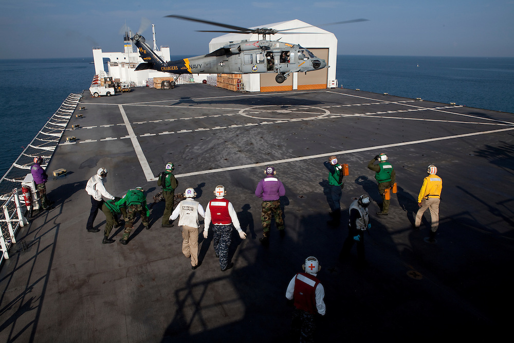 An MH-60S helicopter lands on board the USNS Comfort, a naval hospital ship, for treatment on Wednesday, January 20, 2010 in Port-au-Prince, Haiti. The Comfort deployed from Baltimore, bringing nearly a thousand medical personnel to care for victims of Haiti's recent earthquake.
