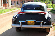 Old American car with wing in Artemisa, Artemisa Province, Cuba.
