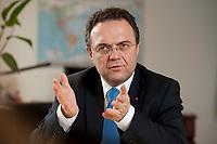 03 JAN 2011, BERLIN/GERMANY:<br /> Hans-Peter Friedrich, MdB, CSU, Vorsitzender der CSU Landesgruppe im Deutschen Bundestag, waehrend einem Interview, in seinem Buero, Jakob-Kaiser-Haus, Deutscher Bundestag<br /> IMAGE: 20110103-01-031