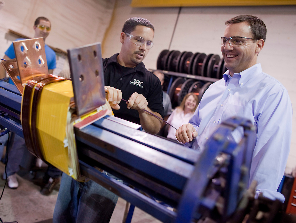 Ontario PC leader Tim Hudak winds copper coil on a transformer during a campaign stop at J.B. Coatings in Chatham Ontario, Tuesday, September 13, 2011.<br /> THE CANADIAN PRESS/ Geoff Robins