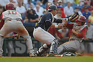 Alabama's Ross Wilson (3) scores as the ball gets past  Mississippi catcher Miles Hamblin during the Southeastern Conference tournament at Regions Park in Hoover, Ala. on Thursday, May 27, 2010. Alabama won 6-3. (AP Photo/Oxford Eagle, Bruce Newman)