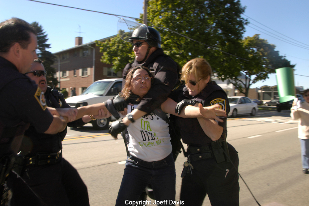 ARLINGTON HEIGHTS, Ill, October 15, 2005-Hundreds of people gathered to protest a meeting of the Minutemen, a vigilante group that patrols the US border and hunts down illegal immigrants. Protesters blocked the main entrance to the conference and hundreds marched around the building where the conference took place.<br /> <br /> Five demonstrators were arrested during the protest in Arlington Heights, the police called in more than 100 additional officers, many in riot gear with helmets and shields<br /> <br /> The Chicago Minuteman Project, was meeting at Christian Liberty Academy, the arrests occurred outside the Academy.