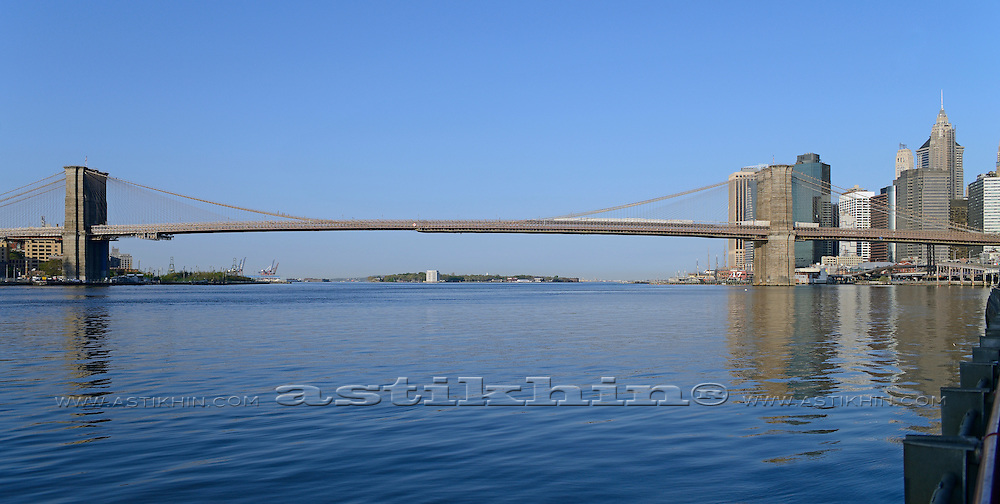 New York City, Brooklyn Bridge with Manhattan at morning.