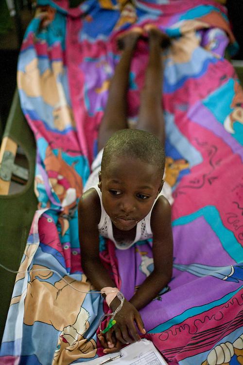 A young cholera patient rests at the Hospital Albert Schweitzer on Saturday, October 30, 2010 in Deschapelles, Haiti.