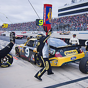 Marcos Ambrosethe Stanley Team pit crew work on the stanley car during pit stop during the Sprint Cup Series AAA 400 Sunday, Oct. 02, 2011 at Dover International Speedway in Dover Delaware.