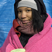 Kaila Harbor, 13, joined in Black Lives Matter protests outside the Minneapolis Police Department 4th precinct headquarters in the neighborhood where she lives on Thursday, November 19, 2015 in Minneapolis, Minnesota. <br /> <br /> Harbor is wearing warm gear from the piles that have been donated at the site, where protests and an encampment have been ongoing since the police shooting of 24-year-old Jamar Clark by Minneapolis Police on Sunday, November 15. <br /> <br /> Harbor, who has been coming to the site &quot;since it started,&quot; said of her hopes for the evening:  &quot;I hope a little bit more happens and we can move the progress.&quot;<br /> <br /> <br /> Photo by Angela Jimenez for Minnesota Public Radio www.angelajimenezphotography.com