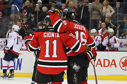 Jan 25, 2013; Newark, NJ, USA; New Jersey Devils right wing Stephen Gionta (11) and New Jersey Devils center Jacob Josefson (16) celebrate Gionta's goal during the first period at the Prudential Center.