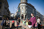Children play with bubbles in the main square of Bienne, Switzerland. Image © Angelos Giotopoulos/Falcon Photo Agency