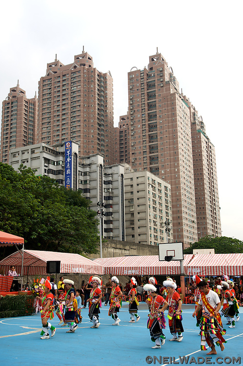 Taiwan aboriginal dancers from the Amis tribe dance in front of a large building in Taipei, Taiwan.