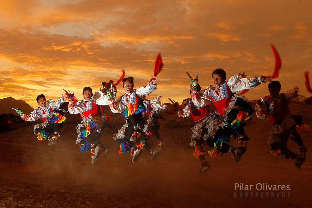 Scissors dancers perform at a archaeological site Huaca in Lima.  The scissors dance is performed by inhabitants of Quechua villages and communities in the south-central Andes of Peru, and now in urban settings. This competitive ritual dance is performed during dry months coinciding with the main phases of the agricultural calendar..(Photo Pilar Olivares)