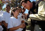 Arnold Schwarzenegger shakes hands with Angela Matsushino, 9, from Bel Air Elementary during Schwarzenegger's press conference in Martinez, Calif. in support of Proposition 49 which would make after school programs available at every public elementary and middle school in California on Oct. 3, 2002. Schwarzenegger is the architect and offical sponsor of Proposition 49 which will be on this November's ballot. Photo by Jakub Mosur