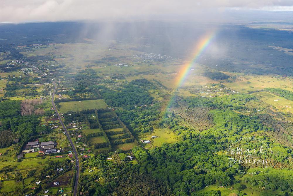 Aerial photo of the Mamalahoa Highway and a rainbow, near Kurtistown, Big Island, Hawaii