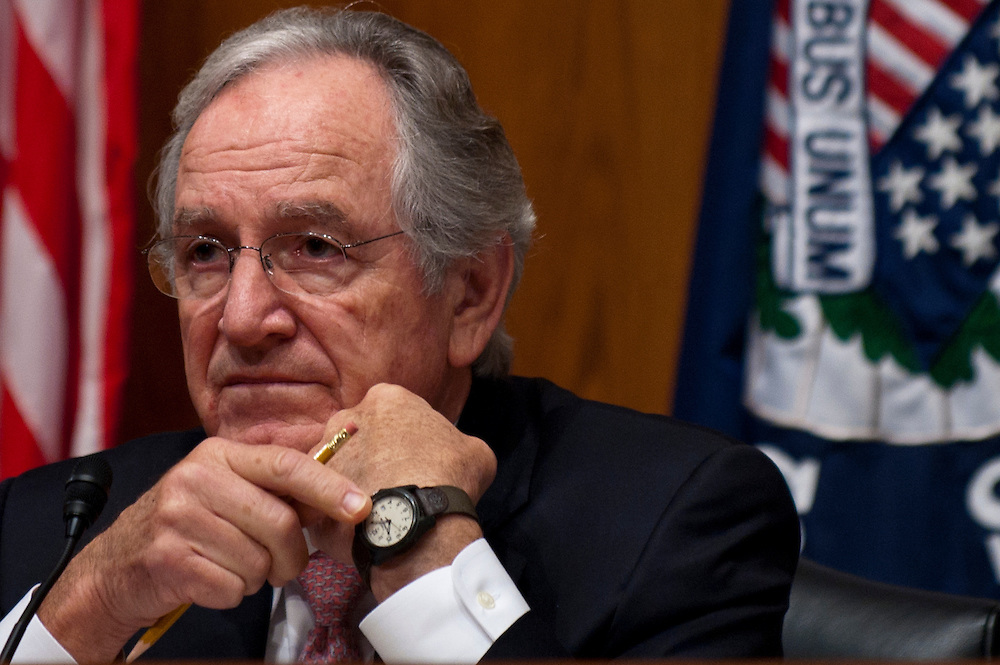 """Senate Health, Education, Labor and Pensions Committee Chairman TOM HARKIN (D-IA) motions to his watch to inform a witness that their time has expired during a hearing on """"The Endangered Middle Class: Is the American Dream Slipping Out of Reach for American Families?"""""""