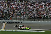 Tony Kanaan beats Dan Wheldon and Vitor Meira to the finish line at the Kansas Speedway, Kansas Indy 300, July 3, 2005