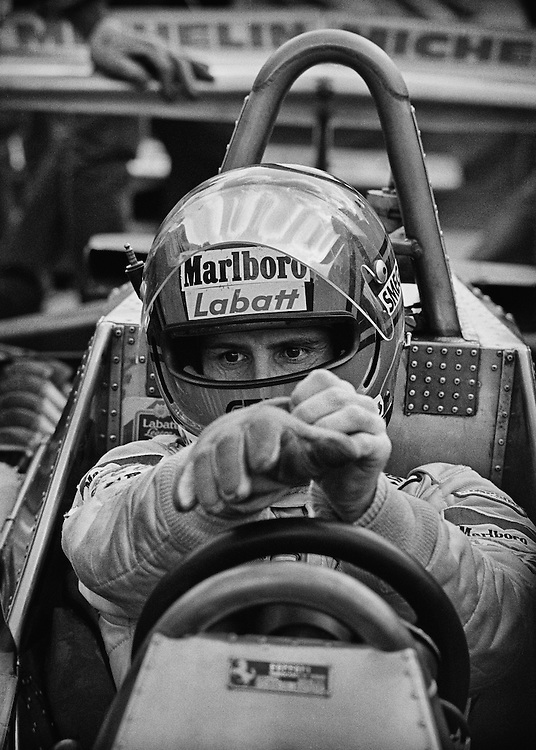 Gilles Villeneuve, alone, he prepares to win the 1979 US Grand Prix. <br /> <br /> You never saw a cadre of engineers surrounding, pleading with Gilles to go faster. <br /> <br /> He said his job with Ferrari was to be the fastest in every practice session, in every qualifying session, through every corner, on every lap, through every lap of a race, and if he was, he would win. World championship titles meant nothing to him if he had to hold back. He was a Formula One driver and that meant being at 100-percent. <br /> <br /> He always had the air about him that he could do things that no one else could; that he could find someway to carry a bad handling car around on his shoulders. <br /> <br /> The press felt it, reveled in it and built his legend one lap at a time. <br /> <br /> His fans, seeing him climb from a smoldering, wrecked Ferrari, felt he had left nothing on the table&hellip;and that Ferrari should just gather themselves and build him a faster car.