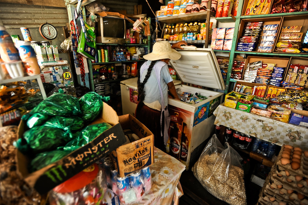 Green bags of dried coca leaves for sale in a roadside stall in the Chapare region of Bolivia.  Coca leaves are a mild stimulate, similar to tobacco, when chewed.