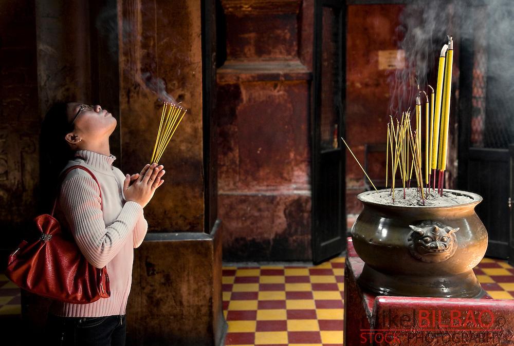 believer in the Taoist Jade Emperor Pagoda (Chua Ngoc Hoang).<br /> Saigon or Ho Chi Minh City, Vietnam, Asia.