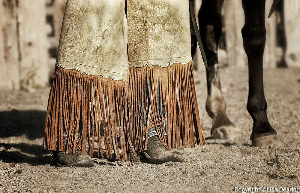 Detail of a Cowgirls Chinks and Boots