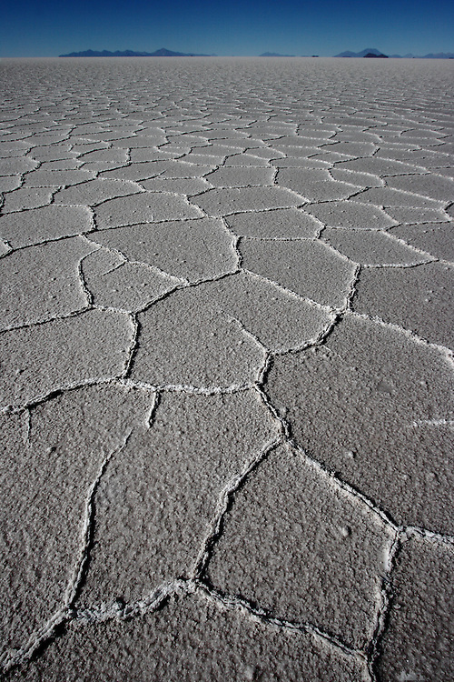 Salt patterns on Bolivia's Salar de Uyuni, the largest salt flat in the world. The patterns are mostly pentagonal, and are submerged by water part of the year. They sit on the Bolivian Altiplano at about 3,600m above sea level