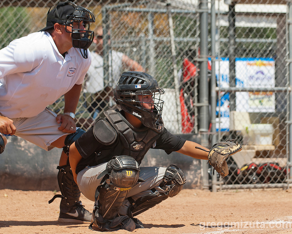Keegan Mizuta catches during the Vale - Payette game at the Snake River Slug Fest Baseball Tournament at Mesa Recreation Park in Fruitland, Idaho on July 27, 2013.