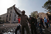 Egyptian protesters taunt nearby security forces during continuing clashes November 22, 2011 near Tahrir square in central Cairo, Egypt. Thousands of protestors demanding the military cede power to a civilian government authority clashed with Egyptian security forces for a fourth straight day in Cairo, with hundreds injured and at least 29 protestors killed.  (Photo by Scott Nelson)