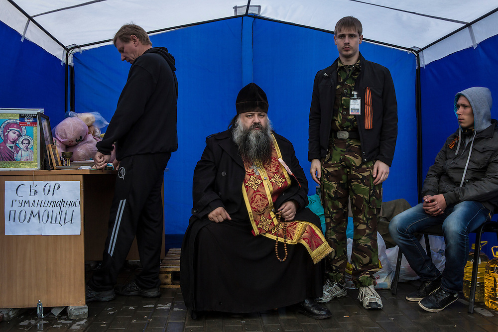 DONETSK, UKRAINE - MAY 8: Ieromonah Opanasiy, an Orthodox priest, in a tent providing humanitarian services to pro-Russian activists outside the occupied regional administration building, which serves as their local headquarters, on May 8, 2014 in Donetsk, Ukraine. Tensions in Eastern Ukraine are high after pro-Russian activists seized control of at least ten cities and ahead of the Victory Day holiday and a planned referendum on greater autonomy for the region. (Photo by Brendan Hoffman/Getty Images) *** Local Caption *** Ieromonah Opanasiy