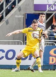Queen of the South's Bob McHugh with Falkirk's Jonathan Flynn.<br /> Falkirk 3 v 1 Queen of the South, Scottish Premiership play-off quarter-final second leg played today at the Falkirk Stadium.