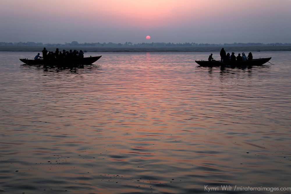 Asia, india, Varanasi. Two boats meet at sunrise on the holy Ganges River at Varanasi.