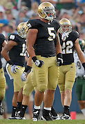 Linebacker Manti Te'o (5) celebrates a stop in the 2011 opening game against South Florida.