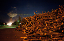 Chopped trees are seen in a logging yard at night where they are turned into chip wood in Kunlun Qi in the Inner Mongolia Autonomous Region of China on 24 April 2011. Inner Mongolia, China's third largest province, is fighting severe desertification, much like the provinces of Xinjiang, Gansu, Qinghai, Ningxia, Shaanxi, Heilongjiang and Hebei. Over-grazing, logging, expanding farms and population pressure, along with droughts have steadily turned once fertile grasslands into sandy plains. China has adopted measures to stop the land degradation such as reforestation, resettling nomadic Mongolians from grasslands to urban areas and restricting grazing areas. Tree planting has become a key government effort to combat desertification and supporting the government's reforestation endeavors are numerous non-governmental organizations (NGOs), such as Shanghai Roots & Shoots. The NGO launched the Million Tree Project in 2007 in Kulun Qi with aims to plant its first million trees by 2014 to hinder the expanding desert. To-date, they have planted more than 600,000 trees.