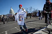 Dwayne Quattlebaum sells t-shirts in front of the Capitol the day before the presidential inauguration, January 20, 2013 in Washington, D.C.