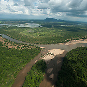 Aerial view over the Mahaweli river with Thoppigala mountain in the distance.
