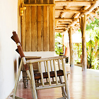 A traditional Guanacaste rocking chair on the porch of a traditional Costa Rican holiday home.