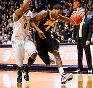 WEST LAFAYETTE, IN - JANUARY 27: Roy Devyn Marble #4 of the Iowa Hawkeyes dribbles to the baseline against Terone Johnson #0 of the Purdue Boilermakers at Mackey Arena on January 27, 2013 in West Lafayette, Indiana. Purdue defeated Iowa 65-62 in overtime. (Photo by Michael Hickey/Getty Images) *** Local Caption *** Roy Devyn Marble; Terone Johnson