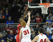 Ole Miss' Murphy Holloway (31) vs. Wisconsin's Mike Bruesewitz (31) in the NCAA Tournament at the Sprint Center in Kansas City, Mo. on Friday, March 22, 2013.